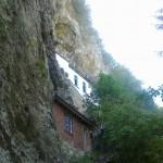 razboish rock monastery - a photo of the monastery from beneath the rocks
